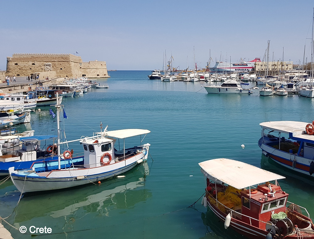 The old Venetian Harbour is at the centre of Crete's capital city Heraklion & has a fortress (Koules) and pretty boars that surround the marina.
