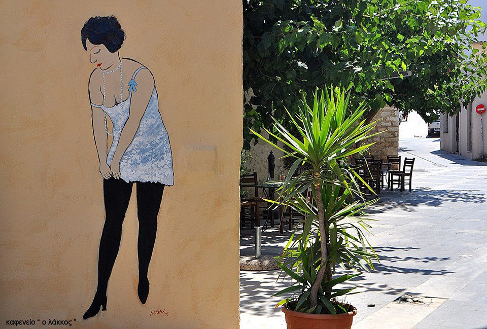 Mural of a working lady at the square in Lakkos, Crete, Greece.