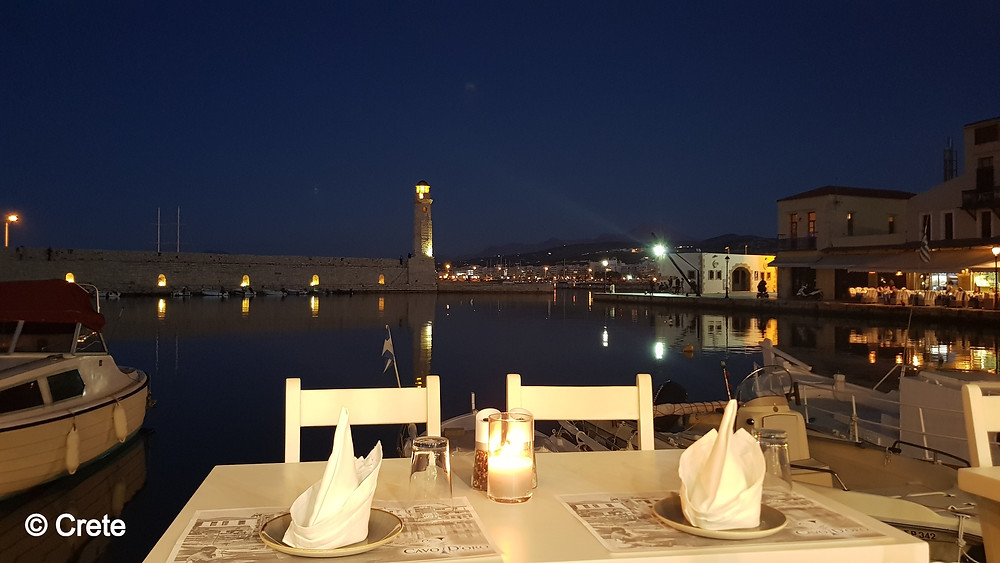 The Venetian harbour of Rethymno in Crete, Greece offers the perfect spot for an atmospheric evening meal in the heart of the town.