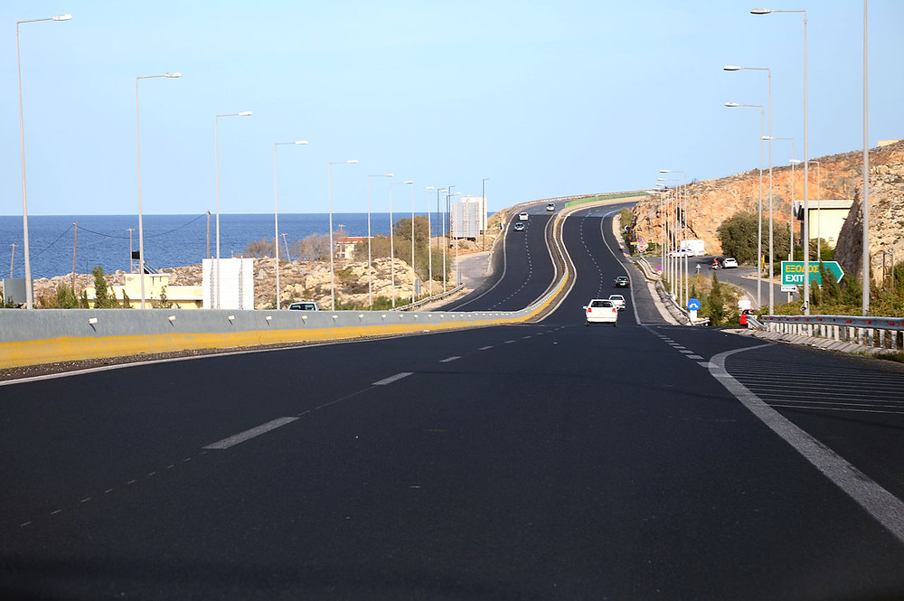 Greek National Road 90 VOAK runs the length of the island of Crete., Greece along the northern coast linking the major towns of Heraklion, Sitia, Rethymno & Chania.