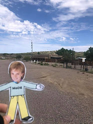 Flat cutout boy in front of old buildings