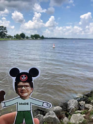 Flat MoDE boy held up in front of a lake