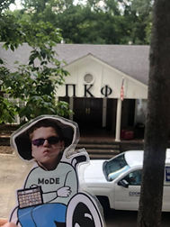 Flat MoDE boy in front of a Pi Kappa Phi house