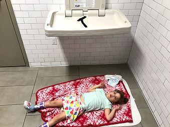 Child on restroom floor
