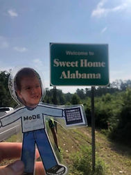 Flat MoDE Boy in front of Welcome to Sweet Home Alabama sign