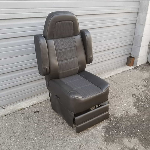 Van & Rv reclining high back captains chair seat with footrest.