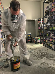 Man mixing paint for construction