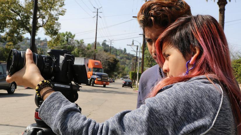 Students adjusting the film equipment