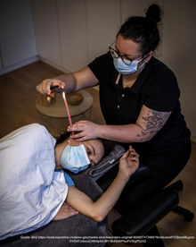 Kopfmassage mit Ohrkerzen Behandlung Riehen