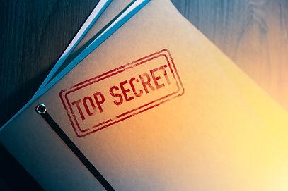 Private investigator desk with top secre