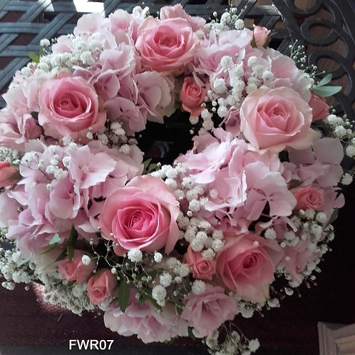 Pink hydrangea, roses and gyp wreath