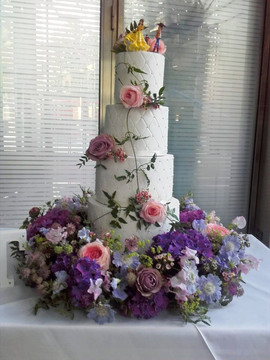 wedding cake decorated with fresh flower