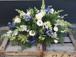 blue funeral spray floral tribute