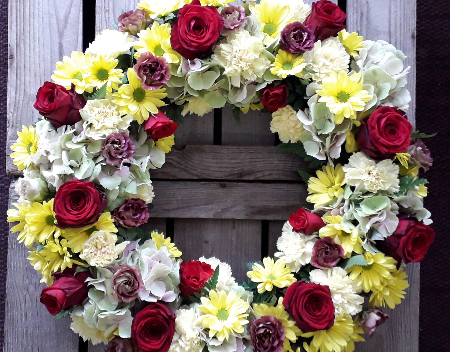 Royal Wreath red roses and yellow funera