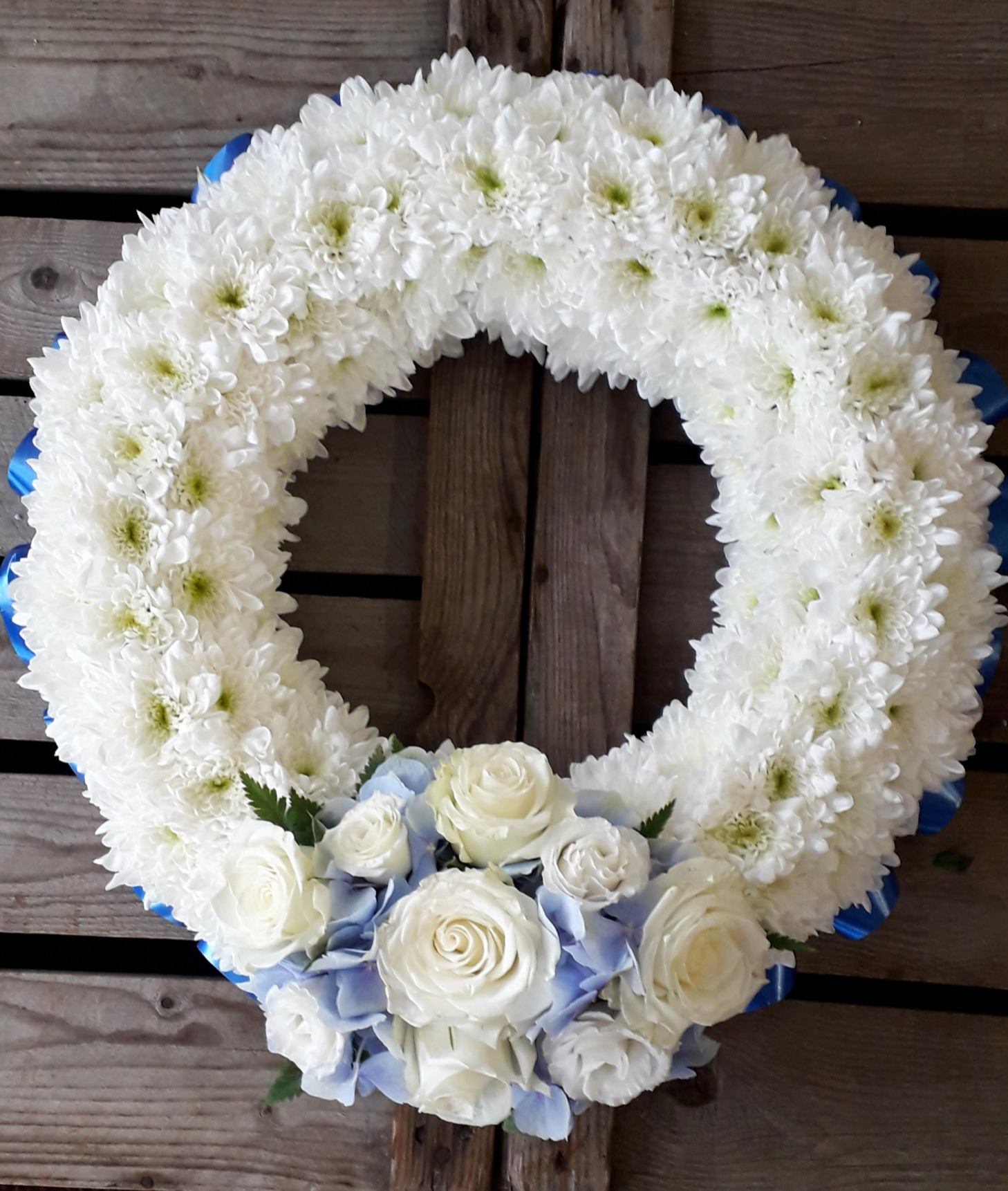 Base blue and white roses funeral flower