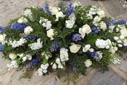 blue and white funeral spray