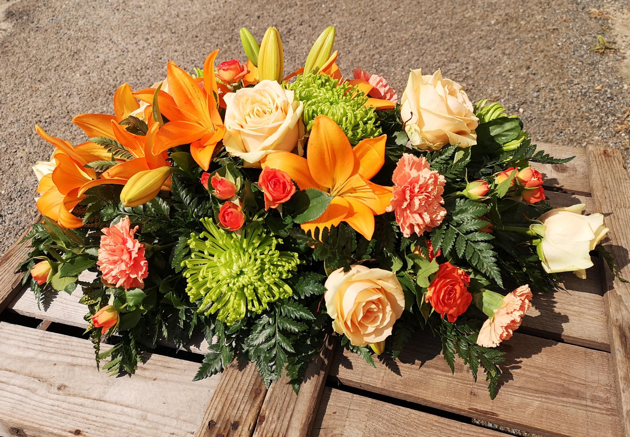 funeral spray orange flowers Ashleigh Ho