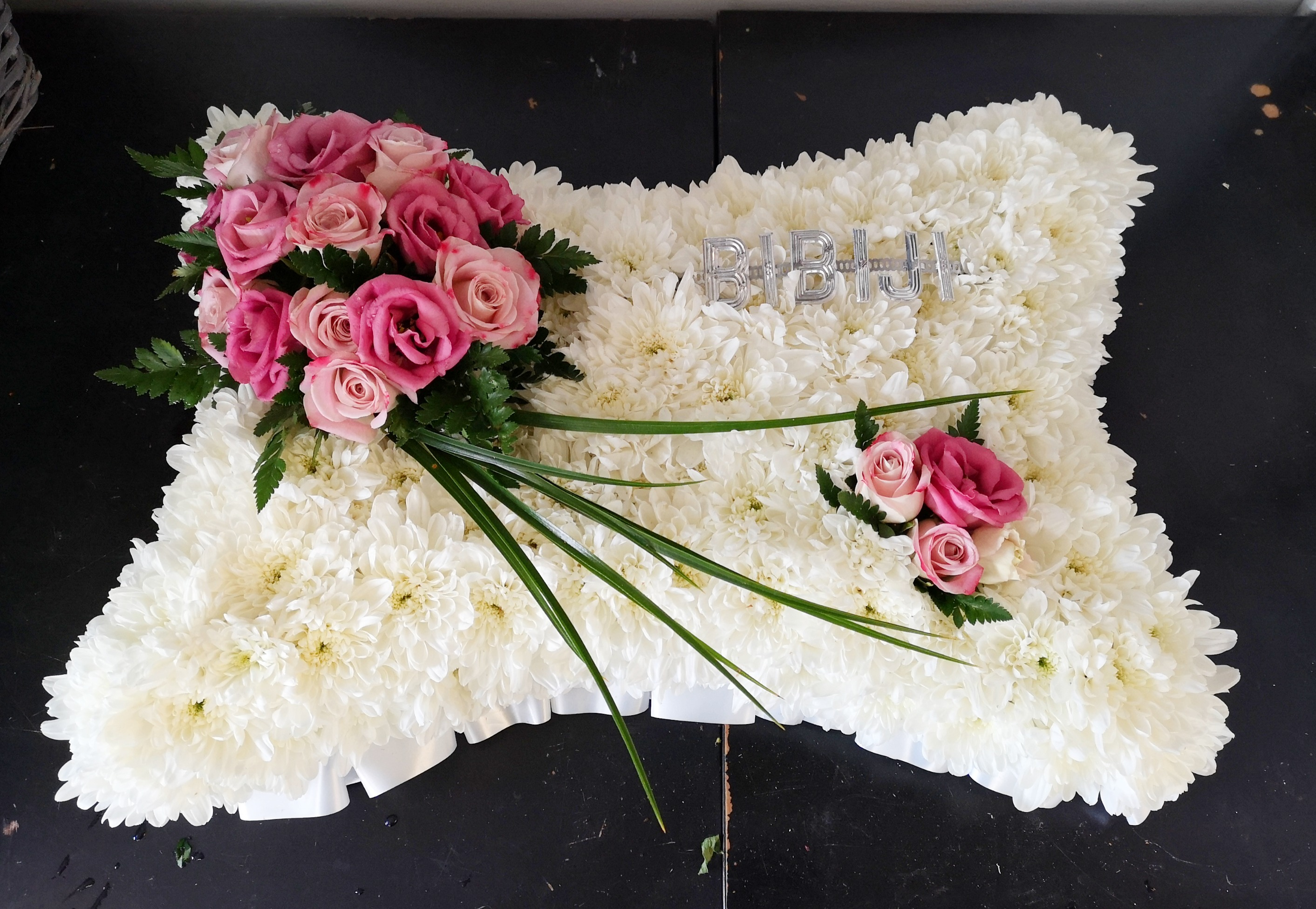 large funeral pillow with pink roses fun