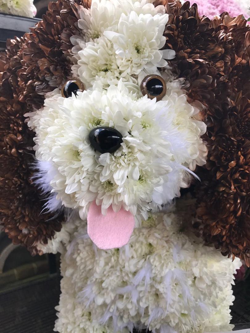 puppy dog flower sculpture funeral tribu