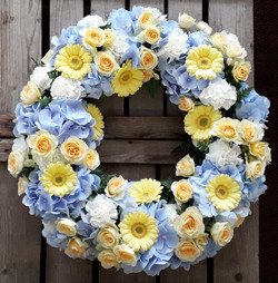 Blue and yellow funeral wreath Ashleigh