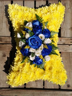blue roses funeral tribute  flower pillo