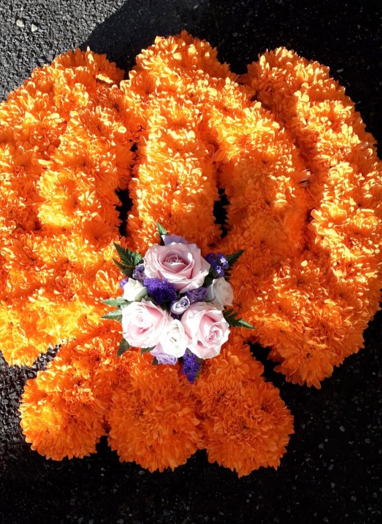 religious funeral flower tribute