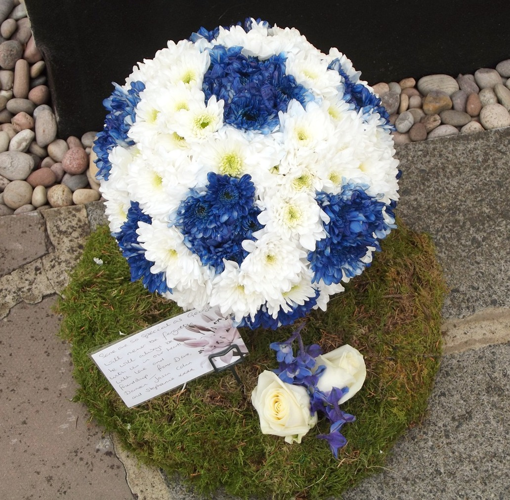 football flower funeral tribute