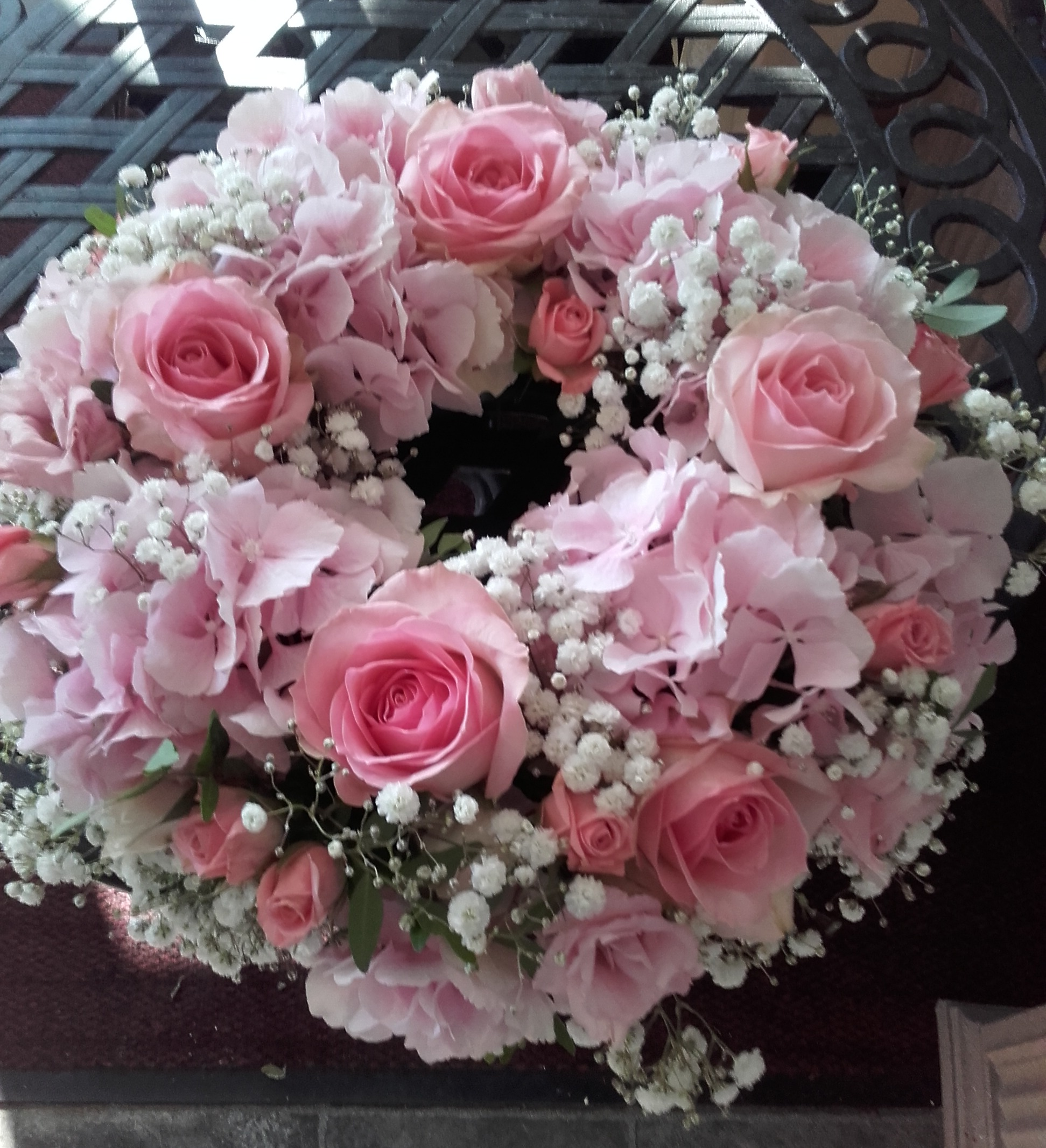 pink roses and hydrangea funeral wreath