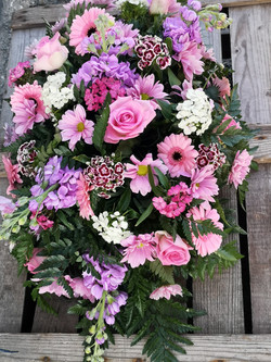 pink and lilac large funeral spray flora