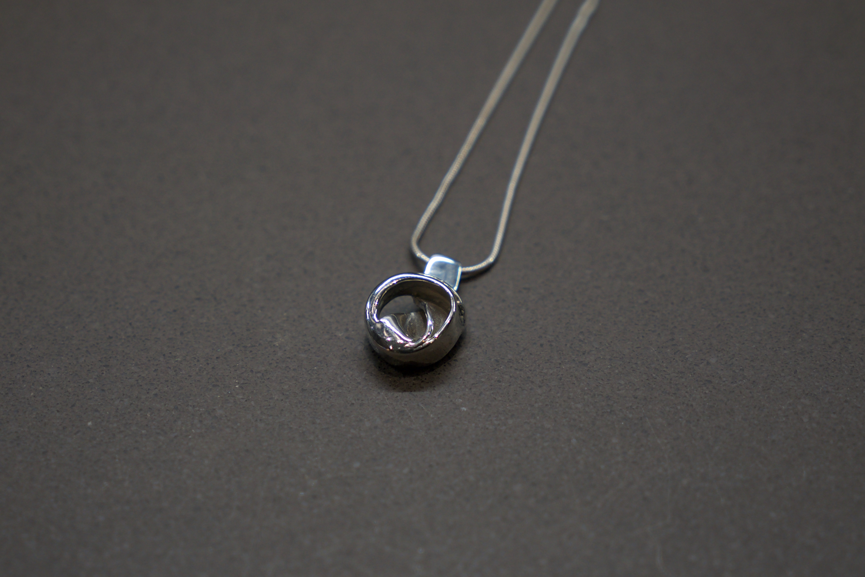 """THE INSIDE TWIST"" pendant"