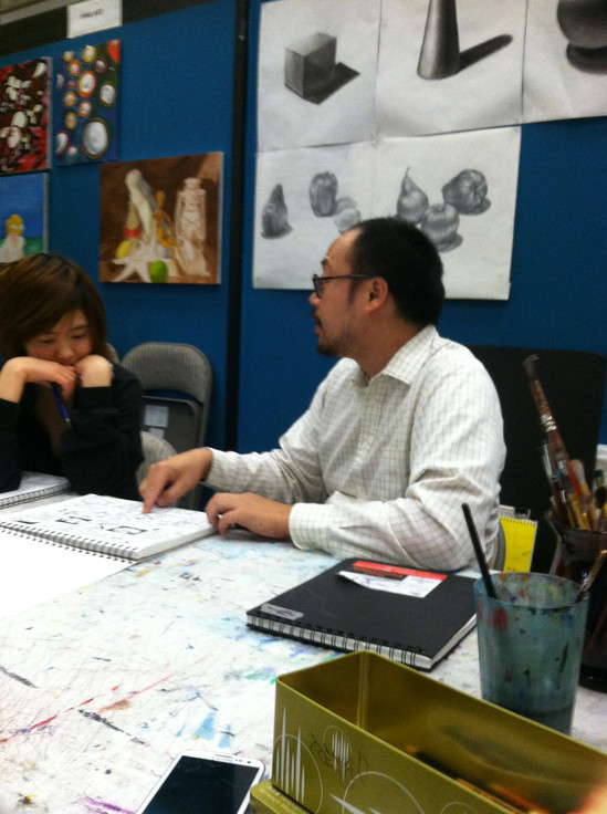 Consulting with Taylor's Art Teacher