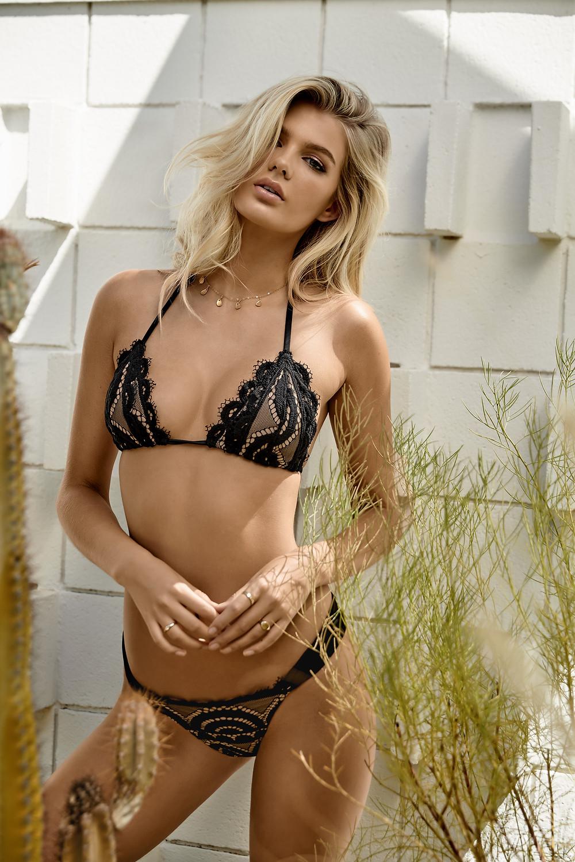 A woman from South Carolina wearing a black D Cup Bikini Top from designer PilyQ she bought online from Sun Vixen Swimwear