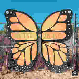 """Rise"", a wooden monarch butterfly sculpture."