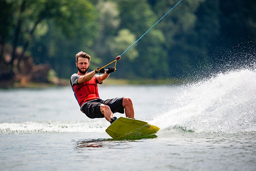 Wakeboarder surfing across a lake.jpg