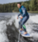 man on wakesurfing wave from the boat._