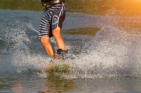 a man engaged in wakeboard on the lake p