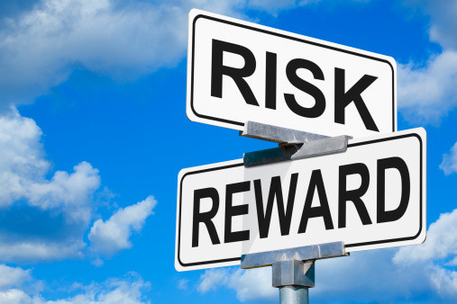 Picture of street signs showing the intersection of risk and reward.