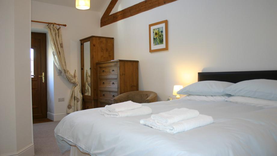 (12) Master bedroom with door onto the decking.JPG