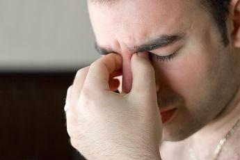 a-young-man-that-has-an-intense-headache