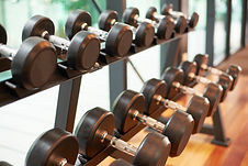 graphicstock-dumbbells-in-the-gym_rOrb1n