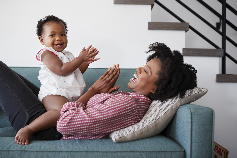 Daughter and Mother clapping hands together.