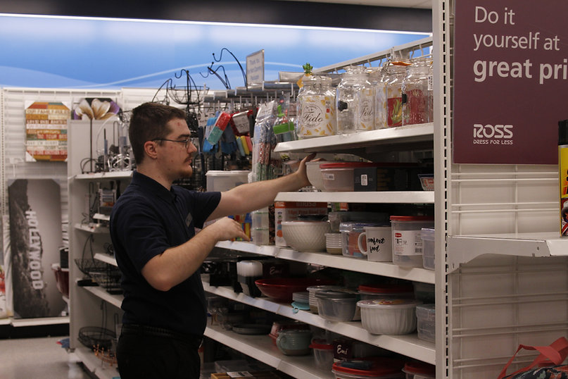 A Vocational Services Program member organizes shelves at Ross Dress for Less.