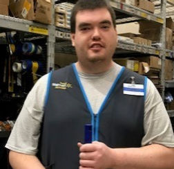 Greg smiles after starting his new job at Walmart