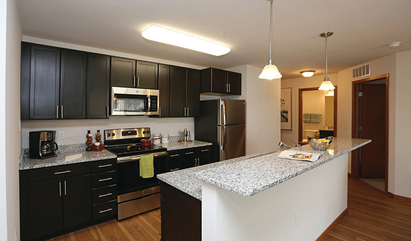 Furnished kitchen area in the model unit