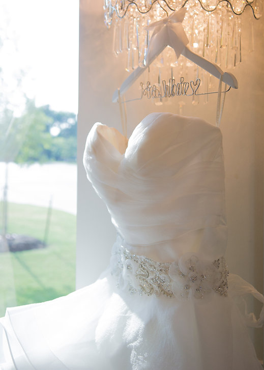 wedding photography of wedding dress at Piazza on the green in McKinney, TX