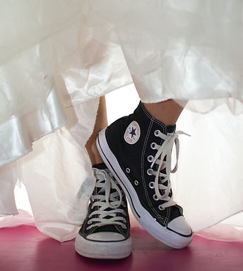 bride wearing converse shoes