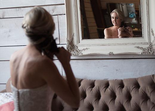bride looking into mirror