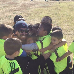 Coach Jose Londono volunteering and having fun with the #LosLobos players!!!_#morethanagame #moretha