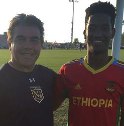 Coach Andreas Grouzis and NUSA player Asfaw from Ethiopa _ordinary_hero _#creatingplayersforlife #mo