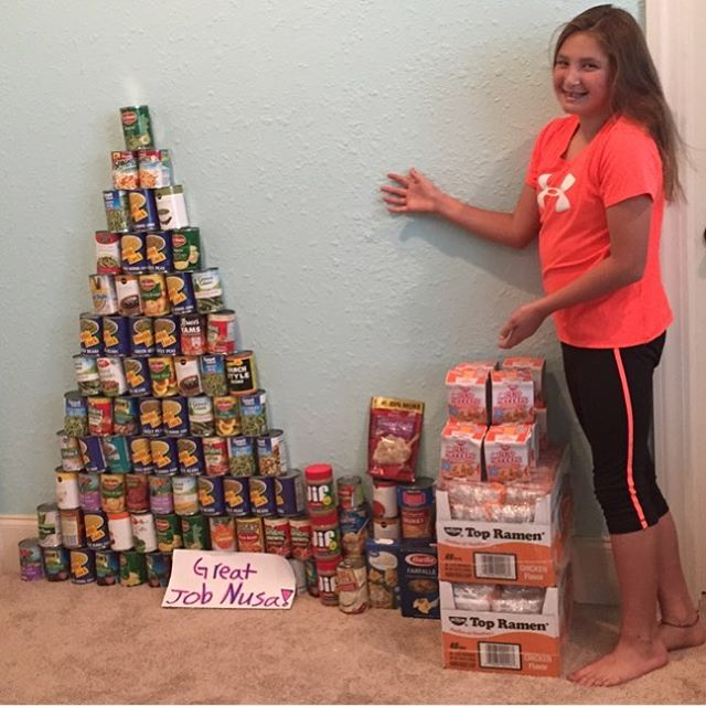 #NUSA Academy player Leah Cohen with a collection of food for the homeless at #thanksgiving _A true